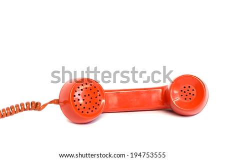 Vintage orange telephone receiver isolated on white background - stock photo