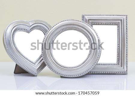 Vintage ornate frames on the table - stock photo
