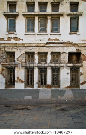 Vintage outdated wall with windows