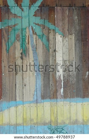 vintage palm on wooden background - stock photo