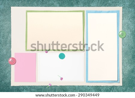 Vintage Paper and fabric On green floor - stock photo