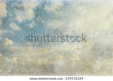 Vintage paper background - white clouds and blue sky - stock photo