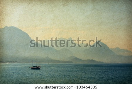 vintage  paper.   Beautiful Mediterranean Landscape with a Yacht   at sunset . Turkey - stock photo