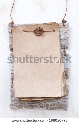 vintage paper for text on a white wooden background, vertical - stock photo
