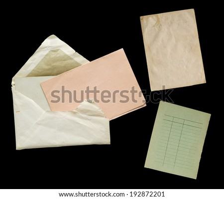 vintage paper objects against a black background - stock photo