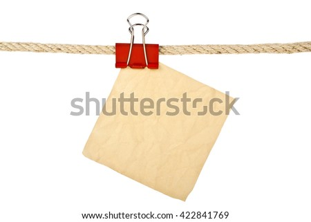 Vintage paper on a rope isolated on white background closeup - stock photo