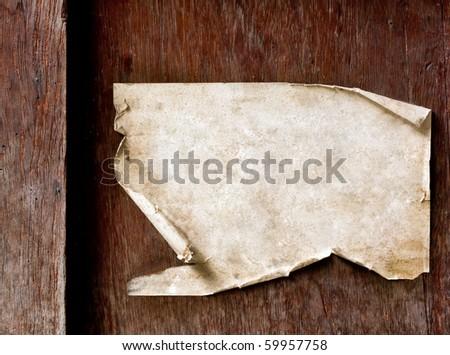 Vintage Paper on dark wood - stock photo
