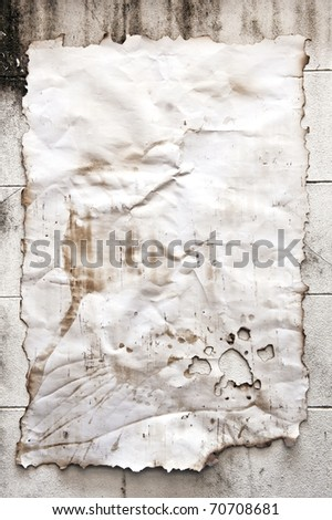 Vintage paper on old brick wall for background - stock photo