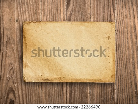 Vintage paper on old wooden table, with clipping path.