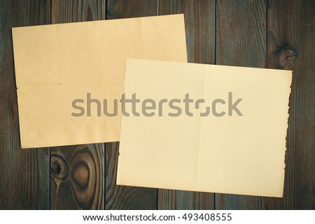 Vintage paper on textured old rustic wooden background