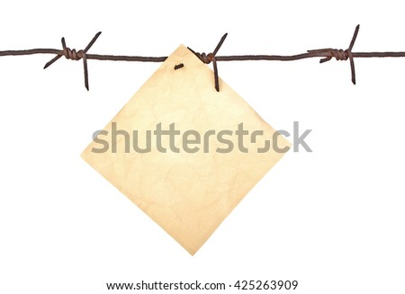 Vintage paper on the rusty barbed wire, close-up - stock photo