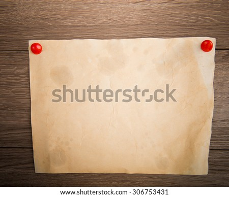 vintage paper on wooden background - stock photo