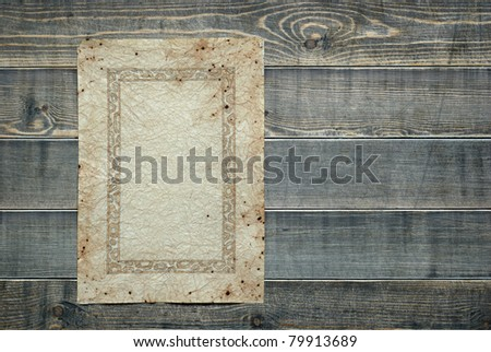 Vintage paper on wooden planks background - stock photo