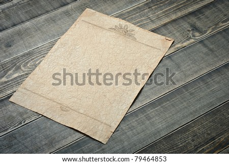 Vintage paper on wooden table - stock photo