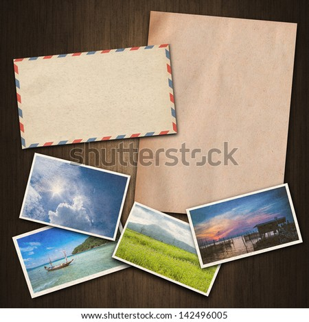 vintage paper , postcard and envelope on wood background - stock photo