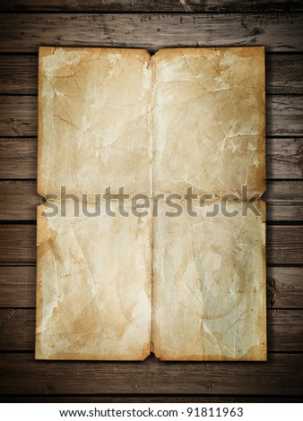 Vintage paper sheet at wood background - stock photo