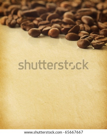 vintage  paper textures. Coffee Beans -very shallow depth of field - stock photo