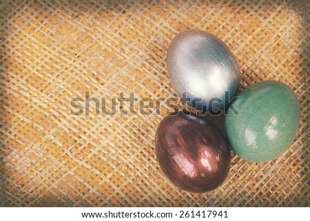 Vintage paper textures, Colorful easter eggs on bamboo weave sheet background, Easter decoration with copy space on the left.  - stock photo
