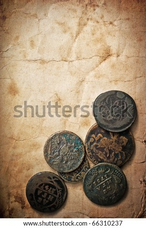 Vintage paper  with coins - stock photo