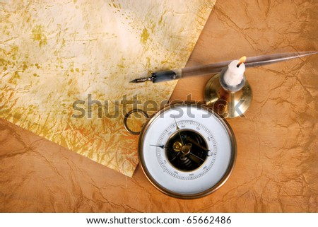Vintage paper with ink feather, a candle and a barometer - stock photo