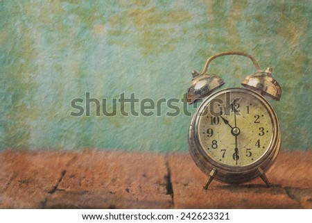 Vintage paper with retro alarm clock on table.10.30 am good time for health - stock photo