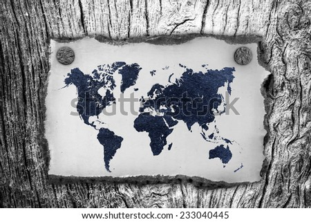 vintage paper  with world map on wall - stock photo