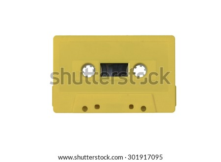 vintage pastel yellow tape cassette - stock photo