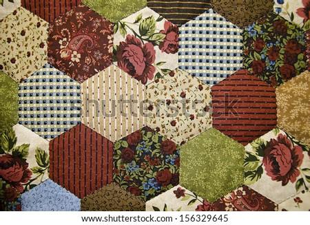 vintage patchwork quilt - stock photo