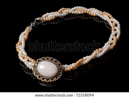 Vintage pearl necklace on black background isolated, a lot of copyspace availabe - stock photo