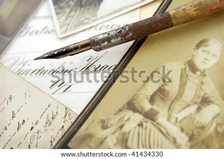Vintage pen and photos - stock photo