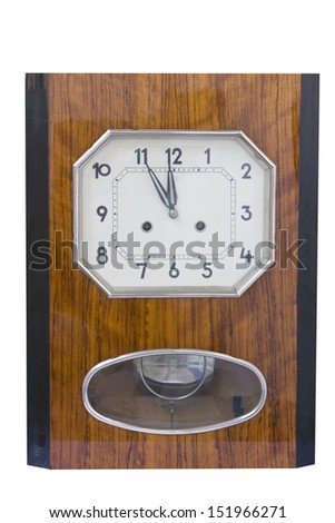 Vintage pendulum clock showing midnight hour isolated on white background