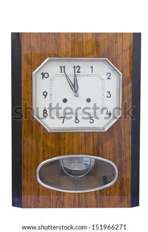 Vintage pendulum clock showing midnight hour isolated on white background - stock photo