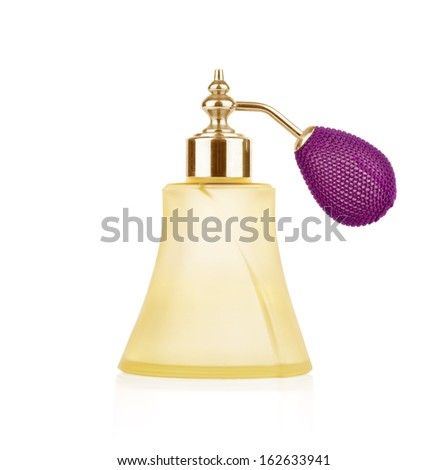 vintage perfume bottle with atomizer isolated on white background. - stock photo