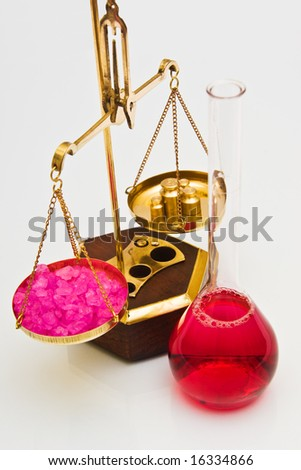 Vintage pharmacy balance scale and beaker with red substance - stock photo