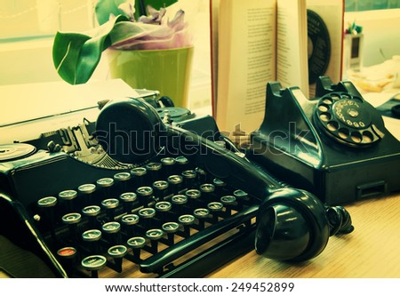 Vintage phone and old typewriter - vintage photo effect - stock photo