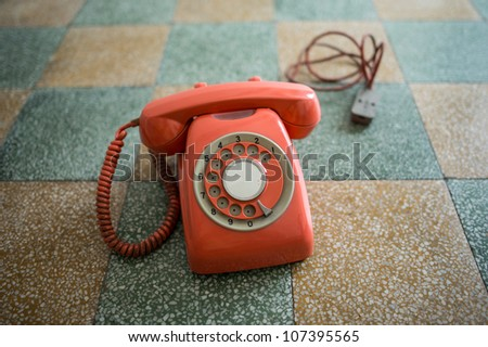 Vintage phone isolated on a floor background. - stock photo