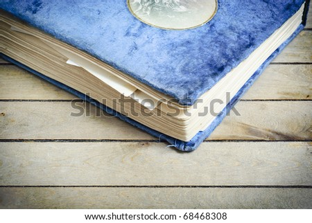 Vintage photo album on a wooden surface - stock photo