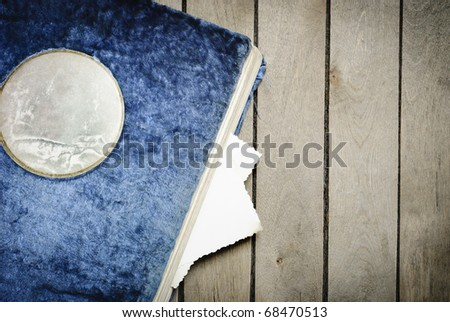 Vintage photo album on an old wooden table - stock photo