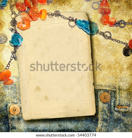 vintage photo-album with blank page and beads - stock photo