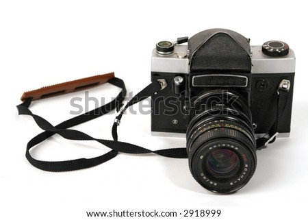 Vintage photo camera with strap - stock photo
