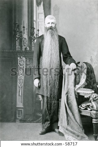 Vintage photo, circa 1900, of a man with a very long beard - stock photo