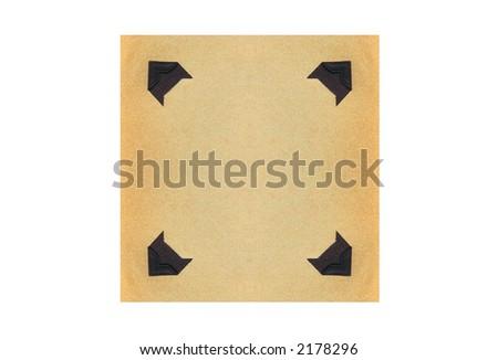 Vintage photo corners on aged paper. - stock photo