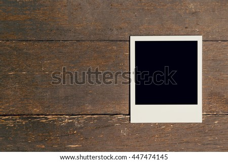 Vintage photo frame blank on old wood background with space - stock photo