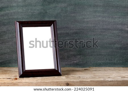 Vintage photo frame on table - stock photo