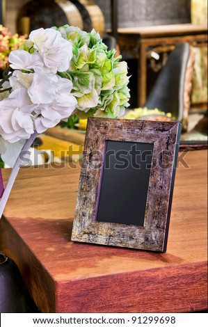 vintage photo frame on the table - stock photo