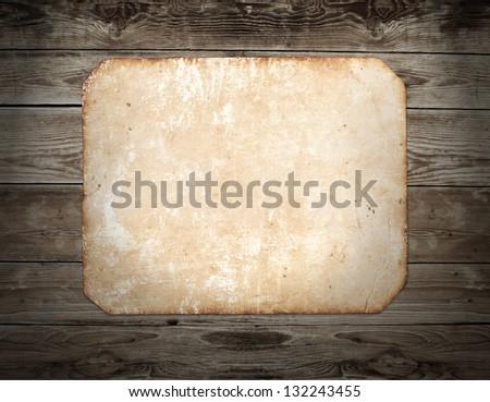 Vintage photo frame on wood background - stock photo