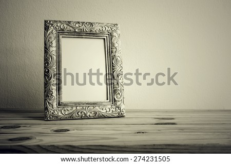 Vintage photo frame on wooden table over grunge background, Still life style - stock photo