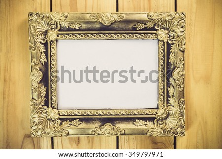 Vintage photo frame on wooden table, Still life style