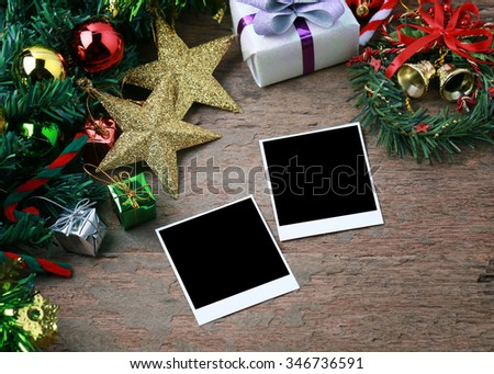 Vintage photo frame with christmas decorations on wood background. - stock photo