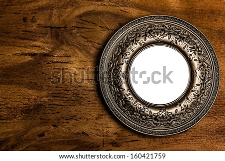 Vintage photo frame with empty space over wooden background - stock photo
